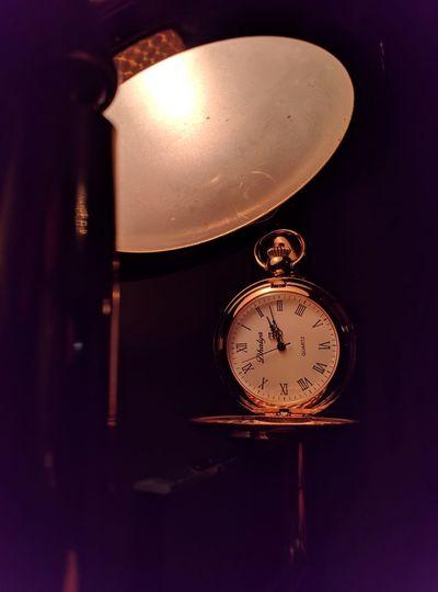 Close-up of illuminated clock