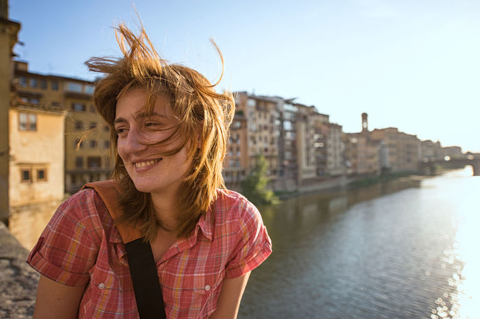 Portrait of young redhead woman on Ponte Vecchio City Florence Ginger Hair Italy One Person Outdoors People Ponte Vecchio Portrait Redhead River Smiling Travel Travel Destinations Tuscany Wind Woman Young