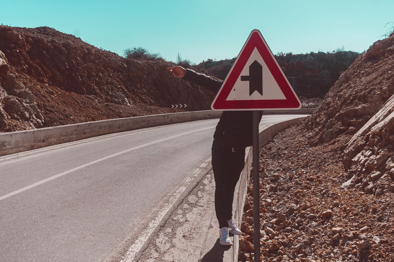 Road sign against mountain
