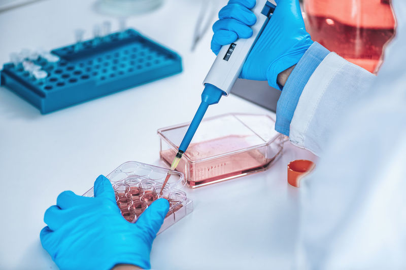 Biotechnology female researcher in laboratory working with cell culture