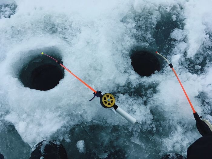 High angle view of fishing rods on frozen lake