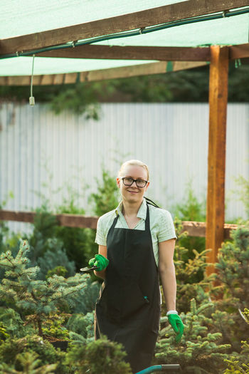 Full length of woman standing by plants