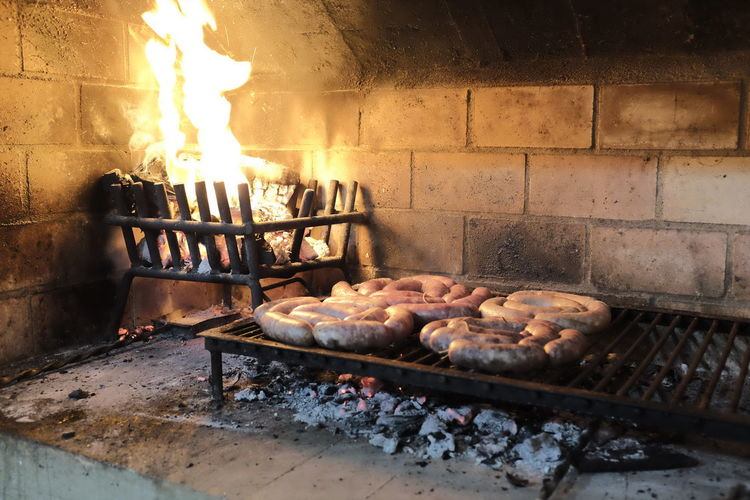 asado argentino Asado Fuego Appliance Asado Argentino Barbecue Burning Fire Fire - Natural Phenomenon Firewood Flame Food Food And Drink Freshness Heat - Temperature Indoors  Kitchen Utensil Log Nature No People Oven Preparation  Preparing Food Wood Wood - Material