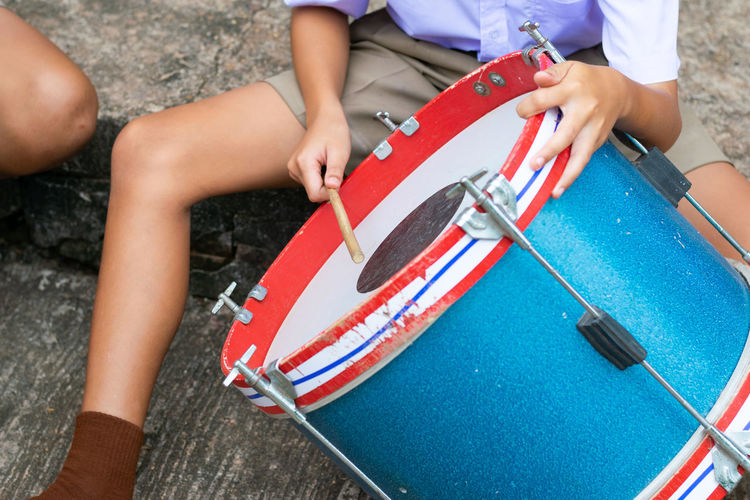 Thai student practice the snare drum at school Marching Band Music Student Thai Student Uniform Day Daylight High Angle View Holding Leisure Activity Lifestyles Musical Instrument Playing Practicing Real People School Snare Drum