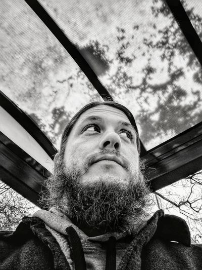 Low angle portrait of man against sky