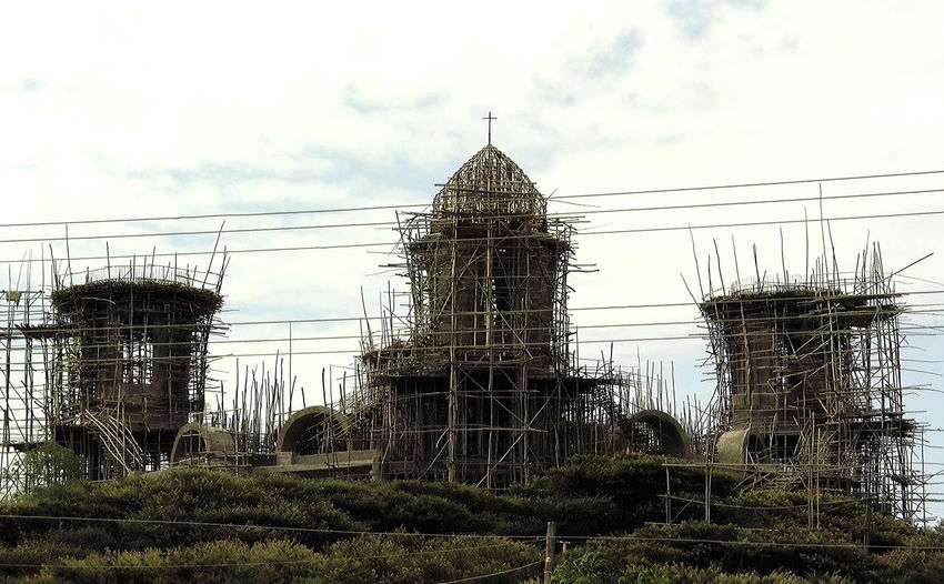 Wooden scaffold at church building site, Ethiopia Architecture Arts Culture And Entertainment Building Exterior Building Site Built Structure Church City Cloud - Sky Construction Day Ethiopia Low Angle View No People Outdoors Scaffolding Scaffolding Church Sky Travel Destinations Wooden Scaffolding
