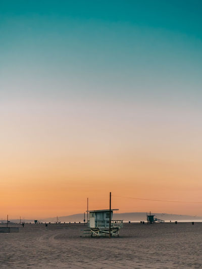 Santa Monica Architecture Beach Beauty In Nature Idyllic Mode Of Transportation Nature Nautical Vessel No People Orange Color Outdoors Scenics - Nature Sea Silhouette Sky Sunrise Tranquil Scene Tranquility Transportation Water Waterfront