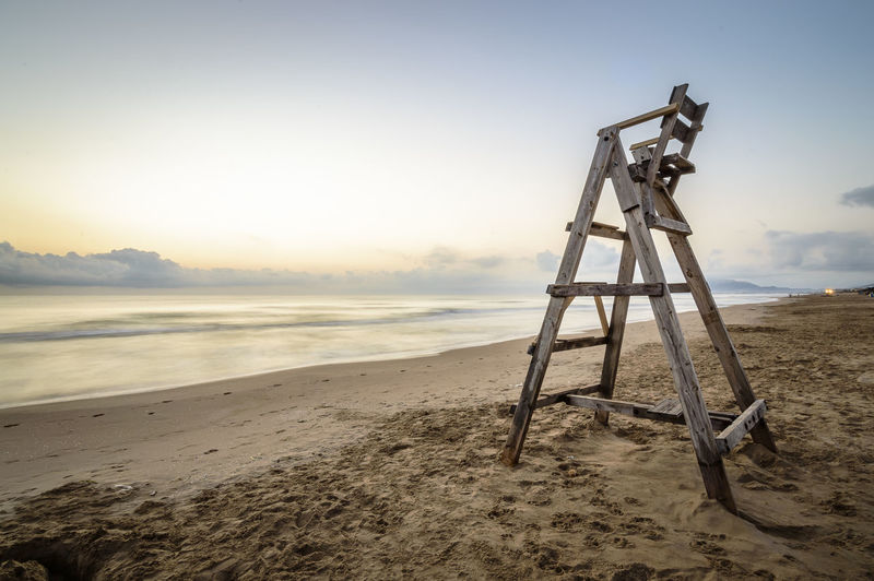 Baywatch chair at sunrise Bay Baywatch Baywatch Tower Beach Chair Coast Coastline Day Mediterranean  Nature Nature No People Ocean Outdoors Sand Sea Sky Summer Summertime Sunrise Sunset The Great Outdoors - 2017 EyeEm Awards Vacations