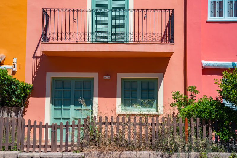 Front door of a beautiful holiday house at Port Saplaya in Valencia. Holiday apartments. Porch. Living coral facade. Architecture Building Exterior Built Structure Building Window Residential District House No People Plant Entrance Day Door Outdoors Tree Façade City Nature Orange Color Wall - Building Feature Red Row House Living Coral Porch Fences Facades Holiday Apartments Resort Country House Village Pintoresque Colorful Buildings Wooden Fence Front Yard Front Door Spaın Valencia, Spain Portsaplaya Mediterranean  Destination Toursim Vacations Relaxing View The Traveler - 2019 EyeEm Awards