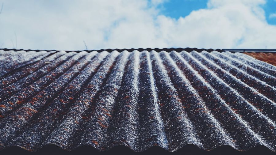 Close-Up Of Roof Tiles Against Sky