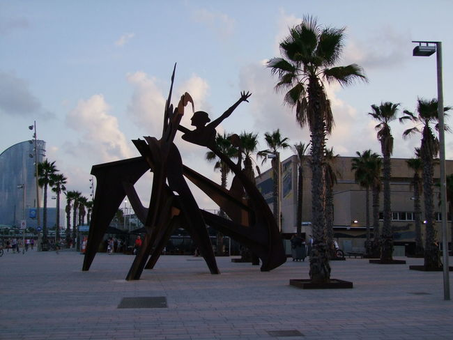 Sculpture, Harbour Area Art Barcelona Blue Sky White Clouds City Composition Creativity Full Frame Incidental People Incidental People. Metal Sculpture Modern Sculpture Outdoor Photography Palm Tree Plaça Sculpture Silhouette Spaın Square Sunset Light Tourism Tourist Attraction  Tourist Destination Twilight Unusual