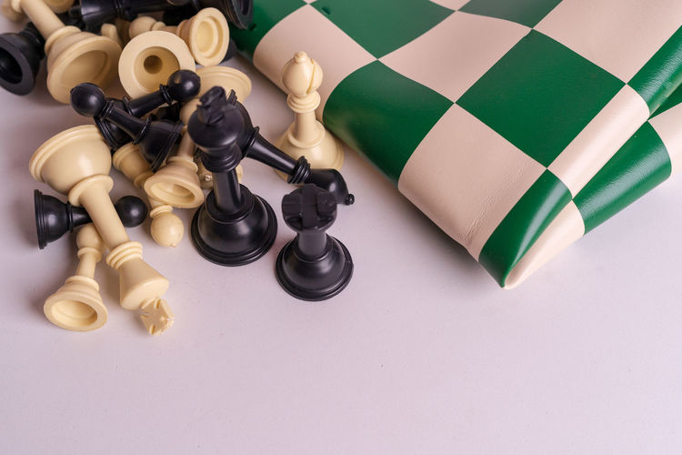Chess set on white background. Indoors  Chess Game Competition Queen King - Royal Person King Army Strategy Leader Leadership Decisions Board Game Leisure Games Chess Piece Still Life No People Close-up Relaxation High Angle View Studio Shot Large Group Of Objects Arts Culture And Entertainment Chess Board Leisure Activity White Color White Background Black Color Pawn - Chess Piece King - Chess Piece Knight - Chess Piece
