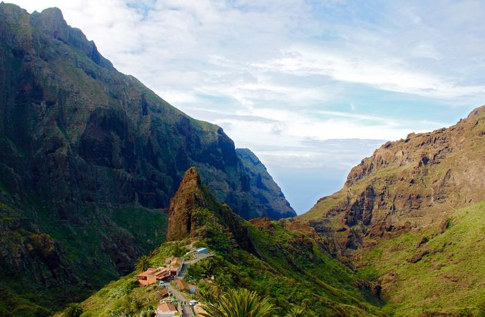 The village hidden in a gorge between two mountains Landscape Landscape_Collection Mountains Mountain Mountain Range Mountain View Mountains And Sky Gorge Village Hidden Hidden Places Sky Sky And Clouds Rock Rock Formation Rocky Mountains Hill Tenerife A Bird's Eye View