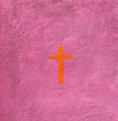Orange Cross On Pink Wall