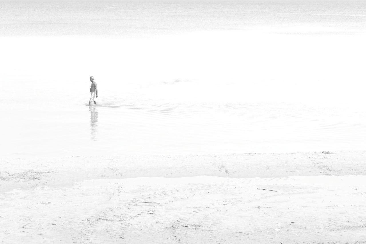 Man Walking In Sea