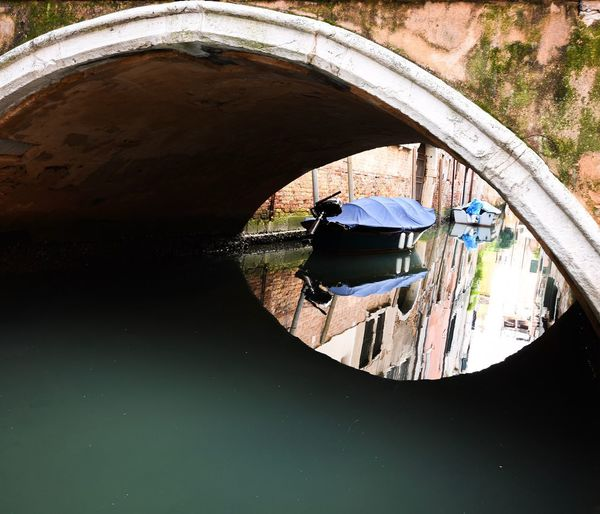 View of arch bridge over canal