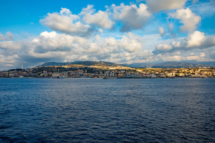 Messina Italy Sicily Ferry Sea Cloud - Sky Water Sky Architecture Waterfront City Building Exterior Scenics - Nature Nature Built Structure No People Beauty In Nature Tranquil Scene Tranquility Land Day Outdoors Building View Into Land TOWNSCAPE