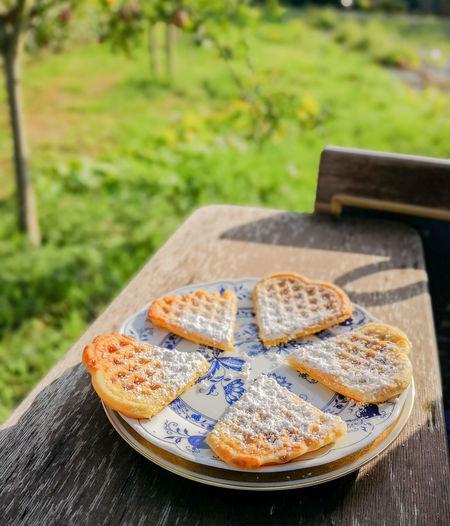 Heart Shape Sweet Food In Plate On Table