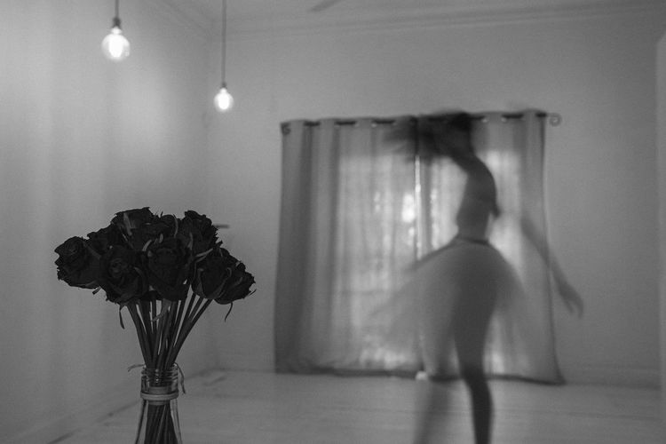 Blurred motion of woman dancing in home