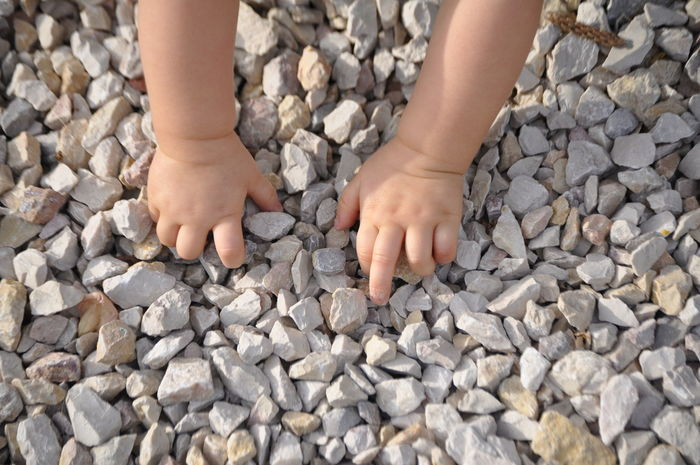 Baby Baby Hands  Balance Carefree Childhood Childwood Cropped Detail Hands Happiness Holding Human Body Part Human Finger Human Hand Part Of Person Personal Perspective Playing Real People Showing Stone Stone Wall