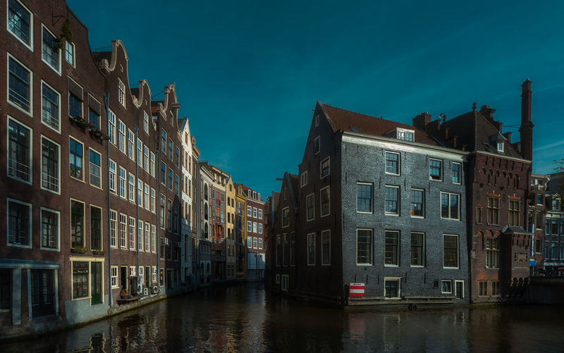 Amsterdam Remo SCarfo EyeEm Best Shots Architecture Built Structure Building Exterior Building Sky Water Waterfront Reflection No People City Nature Canal Window Residential District Blue Night Outdoors Dusk Cloud - Sky Row House