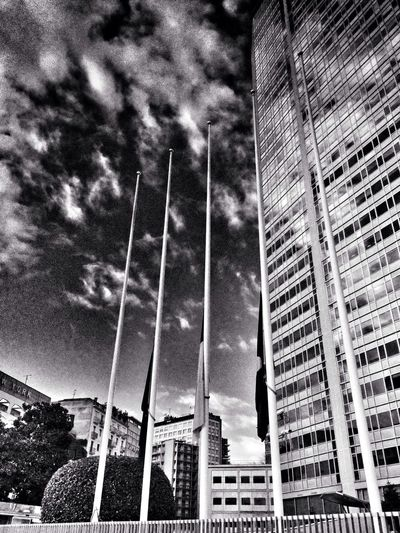 Flags Building Clouds And Sky Black & White