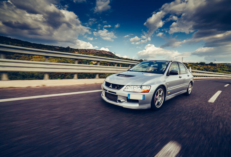 Trieste, Italy - SEPTEMBER 3, 2013: Photo of Mitsubishi EVO 8 .The Lancer Evolution 8 sedan features a newly designed 4B11T 2.0L (1998cc) turbocharged, all-aluminium inline-4 GEMA engine. Asphalt EyeEm EyeEm Best Shots EyeEm Selects EyeEm Gallery Mitsubishi EVO X Motion Blur Subaru Impreza Wrx STi Blue Car Car Fast Cars High Speed Motion Photography Road Trip Speed Transportation