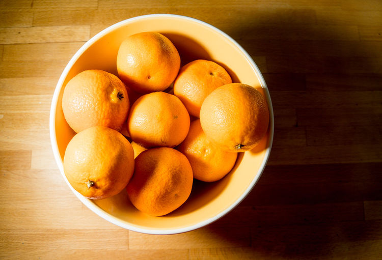 Clementines in a bowl on a wooden counter. Botany Christmas Citrus Fruit Clematis Close-up Counter Countryside Day Food Food And Drink Freshness Fruit Healthy Eating Indoors  No People Orange - Fruit Orange Color