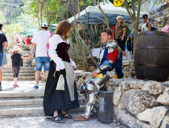 "Jerusalem, Israel, October 03, 2016: Members of the annual festival of ""Knights of Jerusalem"", talk to each other in Jerusalem, Israel Ancient Annual Attraction Christian Citizen Decorations Dressed Event Famous Festival History Holy Israel Jerusalem Knight  Land Medieval Member Old Performance Performs Photographer Pose Sword Tradition"