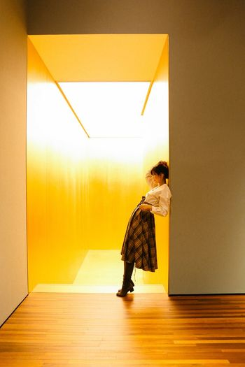 Gold Colored Artmuseum Real People Full Length One Person Wall - Building Feature Lifestyles Architecture Indoors