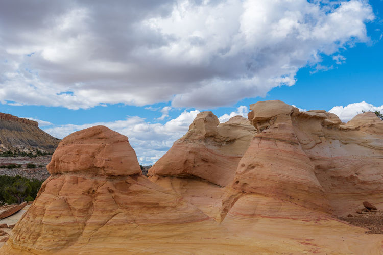 Landscape of large yellow striped conical rock formations at ojito wilderness in new mexico