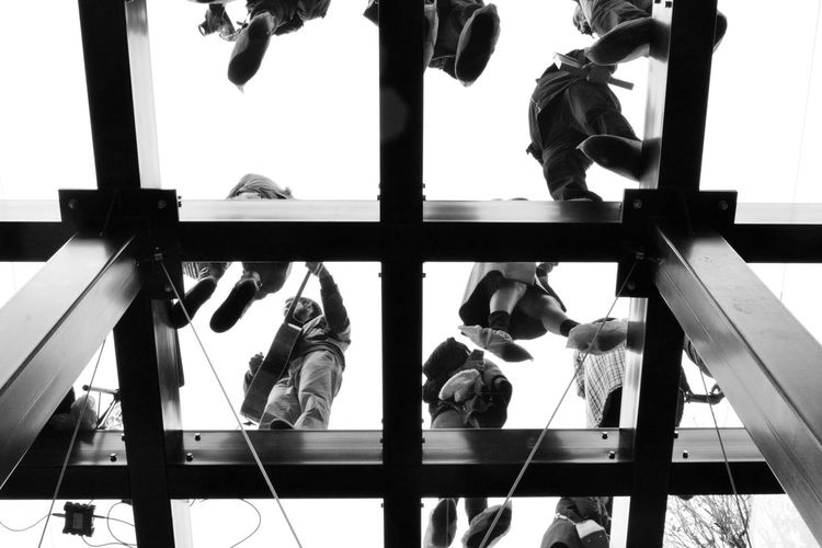 Low angle view of people by window