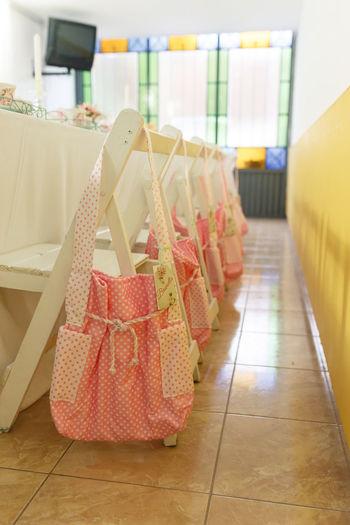 Pink Bags On Tiled Floor In Room