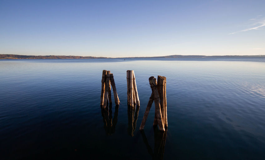 Landscape of lake bracciano in twilight with timber pier