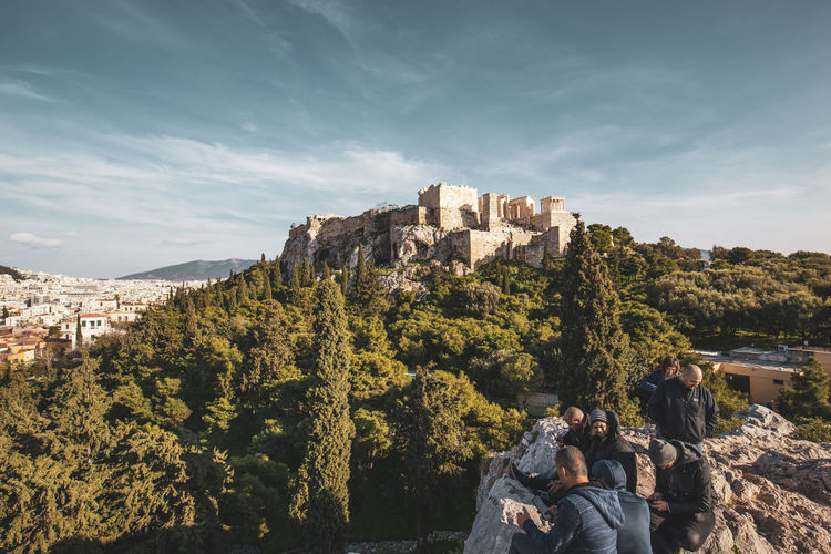 Athens Athens Greece Athens, Greece Acropolis Architecture Real People Built Structure Lifestyles Sky Leisure Activity Women Adult Men Plant Day Nature Building Exterior Tree People Mountain Group Of People History Beauty In Nature Togetherness Outdoors
