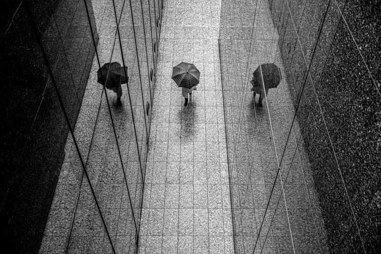 High angle view of people walking on wet floor