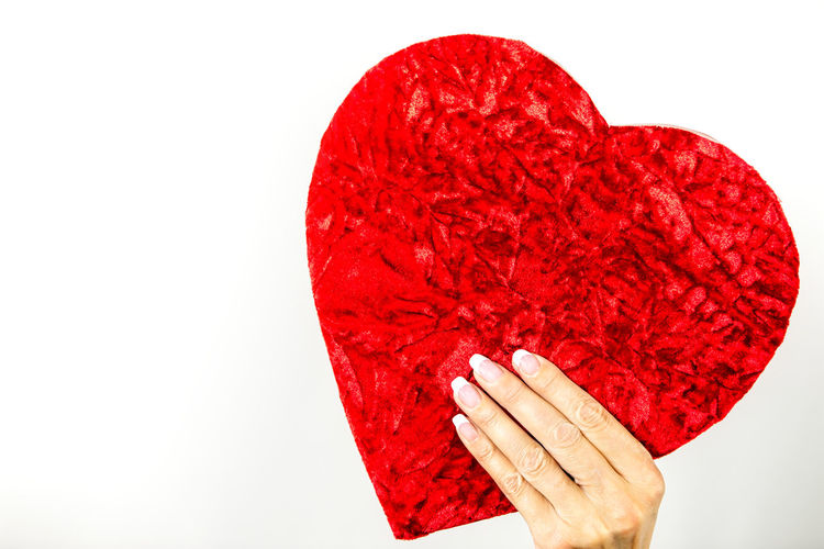 Woman is holding a heart shaped gift box Gift Box Gift Heart Heart Shaped  Love Copy Space Hand Female Hand Caucasian Valentine's Day  Banner Backgrounds Background Romance Emotion Red White Background Human Body Part Human Hand Studio Shot One Person Heart Shape Indoors  Close-up Holding Body Part Cut Out Finger Human Finger Food And Drink Food Temptation Valentine's Day - Holiday