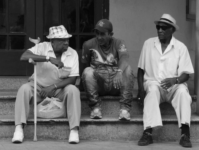 Big and small people on the plaza de revolucion. Black And White Caribbean Cuba, Men, People Santiago De Cuba, Street Photography Street, Talking