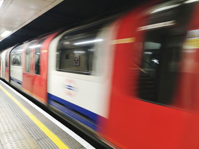 Blurred mornings London Transportation London lifestyle Backgrounds City Subway Train Commuter Train Motion Red Railroad Station Platform Public Transportation Train - Vehicle Arrival Speed Metro Train Train Interior Train London Underground Moving Railway Station Subway Station Passenger Train