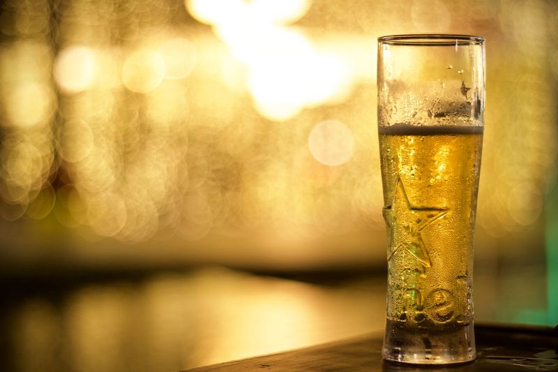 Drink Food And Drink Refreshment Glass Table Alcohol Household Equipment Focus On Foreground Drinking Glass Beer Water No People Close-up Beer - Alcohol Glass - Material Beer Glass Freshness Transparent Illuminated