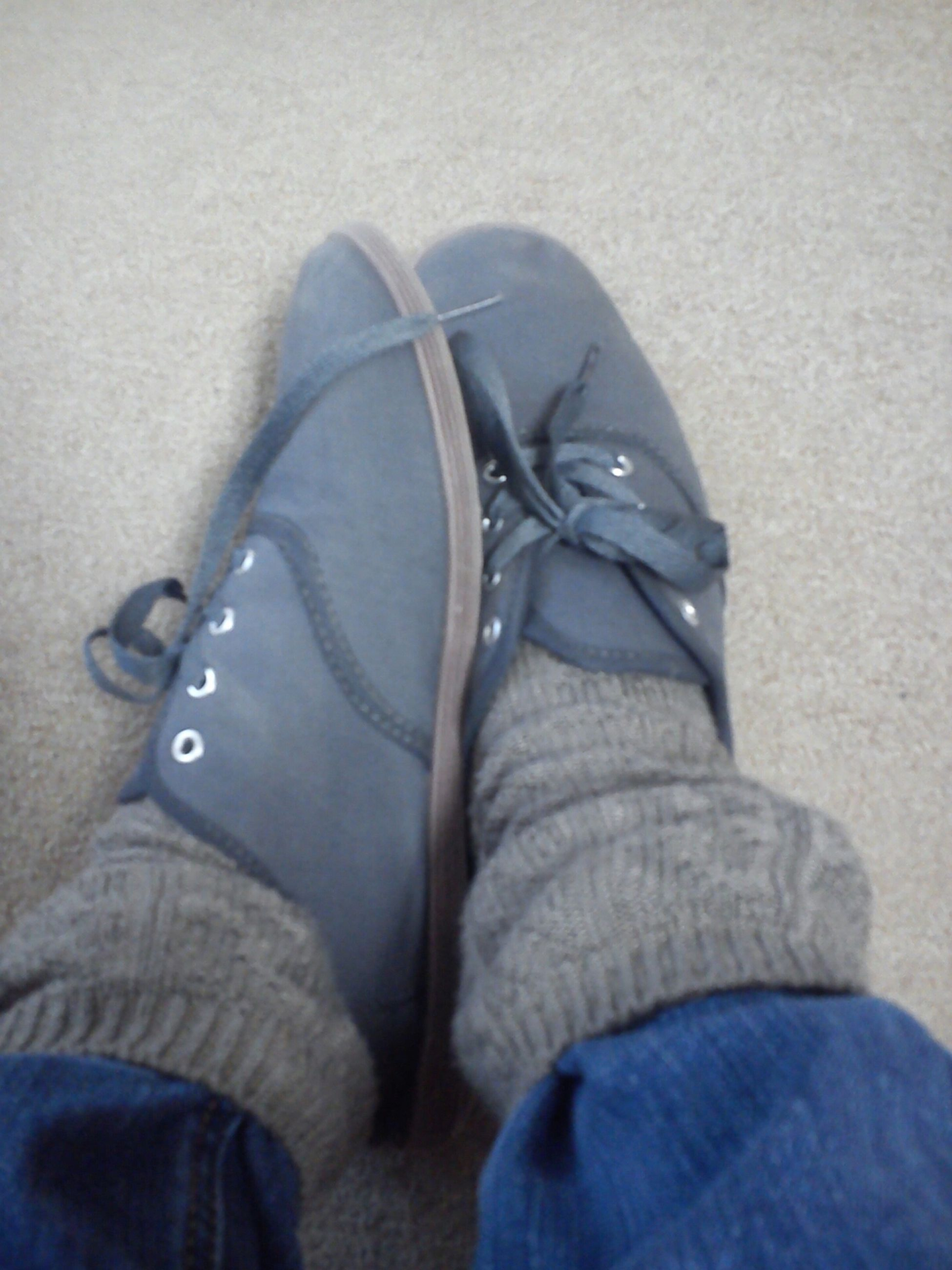 low section, shoe, person, jeans, personal perspective, footwear, lifestyles, high angle view, human foot, men, close-up, leisure activity, pair, part of, canvas shoe, unrecognizable person, fashion