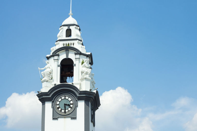 Low angle view of historic clock tower against sky
