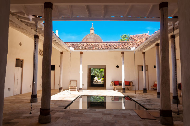 View of a beautiful colonial courtyard with a reflecting pool in Barichara, Colombia Architecture Barichara Barichara...santander Beautiful Colombia Colonial Exterior Historic Historical History Latin Old Road Sandstone Santander Spanish Street Tourism Town Traditional Travel Typical Wall Water White