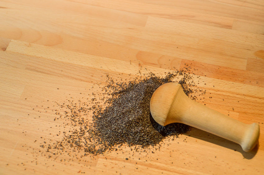 grinding pepper with a wooden pestle Preparing Food Cooking Ingredient Seasoning Wood - Material Wooden Texture Wooden Pestle Grinding Tool Copy Space Textures and Surfaces Wood - Material High Angle View Close-up Food And Drink Ground - Culinary Raw Food Black Peppercorn Ingredient