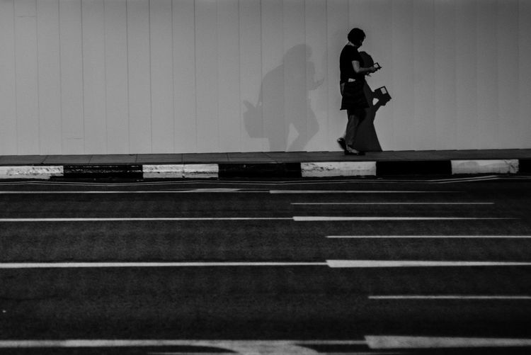 The shadow stalker People Streetphotography Light And Shadow People Photography Streetphoto_bw Monochrome Blackandwhite