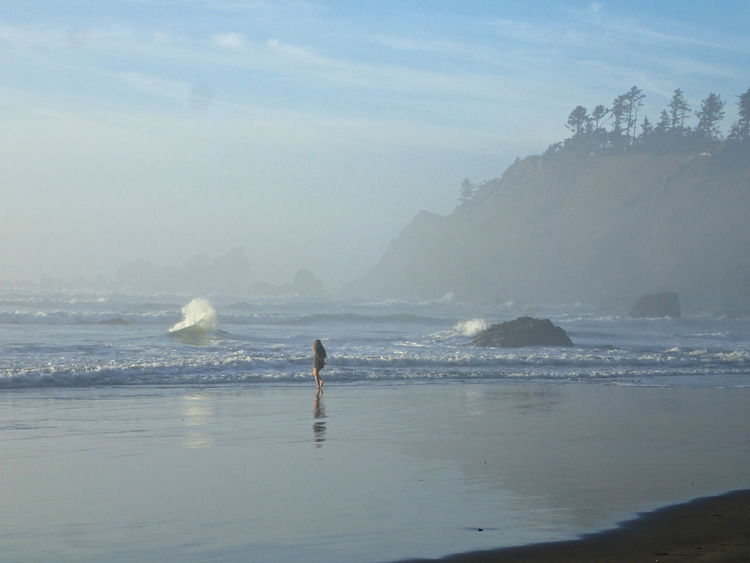 Canon Beach, OR Beach Beauty In Nature Canon Beach Day Full Length Girl Walking In Wate Horizon Over Water Lifestyles Men Motion Nature One Person Outdoors People Real People Scenics Sea Sky Water Wave
