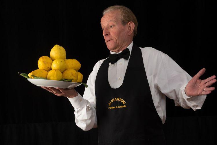 Man holding apple over black background