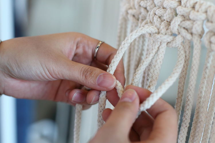 Close-up Hand made macrame. Human Hand Human Body Part Hand Real People Rope Close-up Adult Body Part Women Indoors  Focus On Foreground Jewelry Strength Selective Focus Lifestyles Finger Human Finger Luxury Human Limb Weaving Craft Crochet Pattern Macrame Detail Plant Bohemian Fabric Texture Boho DIY Home Made Handmade Decor Eco Decoration Element Fashion Green Hobby Vintage Scandinavia Knotted Wood Setting Tradition Females House Time