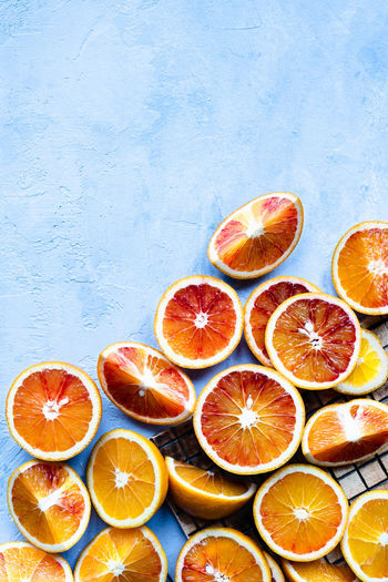 cutted blood oranges from above with negative space   daylight food photography Fruit Citrus Fruit Food And Drink Healthy Eating Food Orange - Fruit Orange Color Orange Freshness SLICE Blood Orange No People Still Life Directly Above Blue Background Food Photography Foodphotography Daylight Photography Nikonphotographer Large Group Of Objects Indoors  negative space