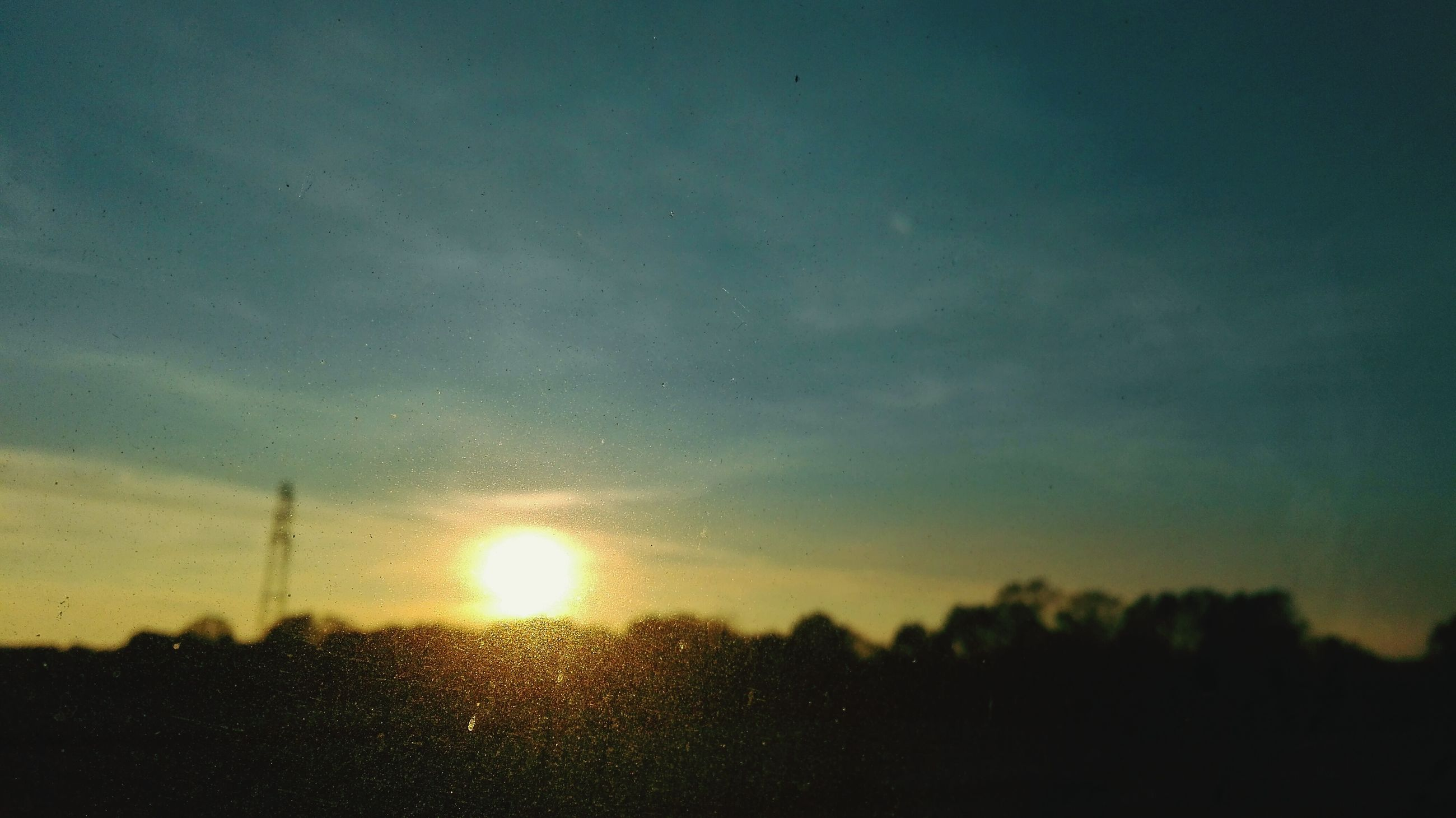 sunset, sky, scenics, sun, beauty in nature, silhouette, tranquility, tranquil scene, nature, orange color, drop, wet, landscape, water, idyllic, transparent, window, no people, dusk, outdoors